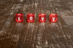 Red dice with word LOVE Stock Image