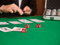 Red dice and a playing card on the table Royalty Free Stock Images