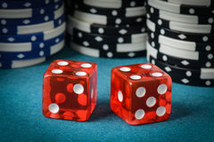 Red Dice and Playing Chips Royalty Free Stock Image