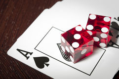 Red dice on spreaded cards Royalty Free Stock Photo