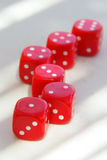 Red dice on table stock photos
