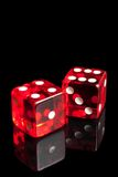 Red dice on transparent black background Royalty Free Stock Photo