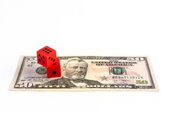 Red dice on 50 US dollar bill. Red dice on 50 US dollar bill on white background with copy space royalty free stock image