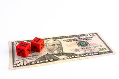 Red dice on 50 US dollar bill. Red dice on 50 US dollar bill on white background with copy space gambling problem concept stock image