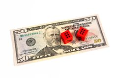 Red dice on 50 US dollar bill. Red dice on 50 US dollar bill on white background - gambling issue concept royalty free stock photography