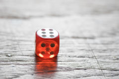 Red Dice on Wooden Table Royalty Free Stock Photos