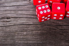Red dice on a wooden table Royalty Free Stock Photography