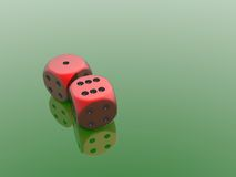Red dices. On green background Stock Image