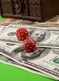 Red dices and chest money Royalty Free Stock Image