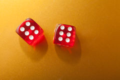 Red dices on gold Royalty Free Stock Image