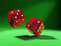 Red dices on green background. 3d illustration of two red transparent dices on green backgroung Royalty Free Stock Photography