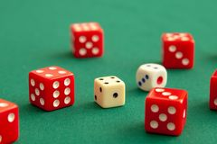 Red dices on green poker gaming table in casino. Concept online gambling stock photos