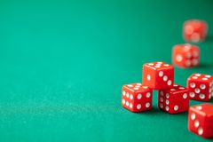 Red dices on green poker gaming table in casino. Concept online gambling. Copy space for text stock photography