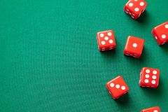 Red dices on green poker gaming table in casino. Concept online gambling. Copy space for text stock image