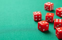 Red dices on green poker gaming table in casino. Concept online gambling. Copy space for text royalty free stock photo