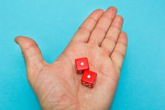 Red dices in the hand, failure stock photos