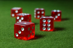 Red Dices Over Green Surface Stock Photography