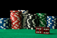 Red dices and poker chips Royalty Free Stock Images