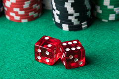 Red dices and poker chips Royalty Free Stock Image