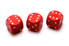 Red dices. On white background royalty free stock image