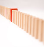 Red difference. Queue of block with one red piece, conceptual image Stock Photography