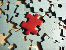 Red different. Puzzle on the other grey puzzles Royalty Free Stock Photo