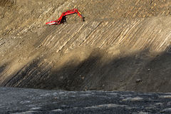 Red digger in stone-pit Stock Image