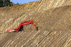 Red digger in stone-pit Stock Photos
