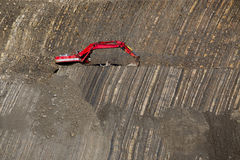 Red digger in stone-pit Royalty Free Stock Image