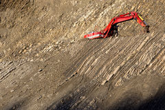 Red digger in stone-pit Royalty Free Stock Images