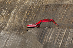 Red digger in stone-pit Royalty Free Stock Photo