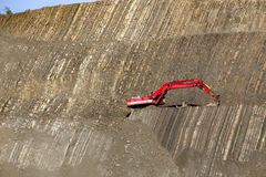 Red digger in stone-pit Royalty Free Stock Photography
