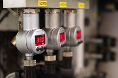 Red digital pressure metering devices Stock Images