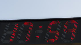 Red digits clock 17.59 Stock Photo