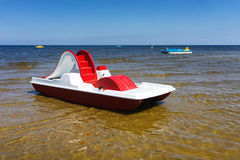 Red dinghy on the golden beach of the Baltic Sea Stock Photography
