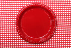 Red Dinner Plate. Red Dinner Lunch Plate on red and white checkered background Stock Images