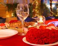 Red dinner table. With roses and glasses Stock Photography