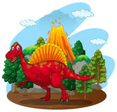 Red dinosaur with volcano behind Royalty Free Stock Photography