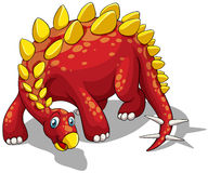 Red dinosaur with yellow spikes on white Royalty Free Stock Photography