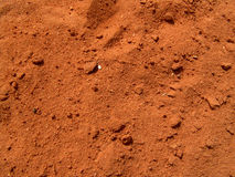 Red Dirt. Texture of red dirt on baseball field Royalty Free Stock Image