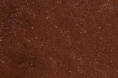 Red dirt background texture pattern. Dirt background texture pattern of the red clay soil of the south west royalty free stock images