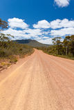 Red dirt road. Through Stirling Range National Park, Western Australia stock image
