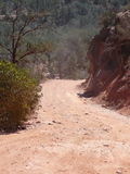 Red Dirt Road. Photograph down a red dirt road in Sedona, Arizona. Beautiful landscape and rock formations along the sides of the road stock photography