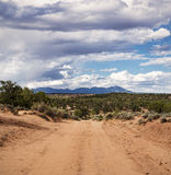 Red Dirt Road Heading for the Mountains Royalty Free Stock Image