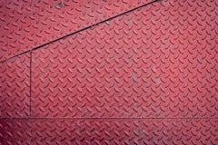 Red dirty metal plate, metallic grunge texture Royalty Free Stock Photo