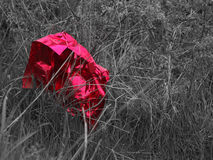 Red discarded packaging - selective colour Royalty Free Stock Photography