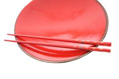 Red dish and chopsticks with oriental style stock images