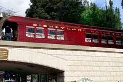 Red Disneyland Railroad at entrance of Disneyland Stock Image