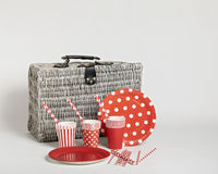 Red disposable tableware for parties and picnics. Royalty Free Stock Image