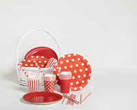 Red disposable tableware for parties and picnics. Royalty Free Stock Photo